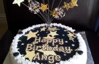 Black & Gold stars birthday cake with wired star topper